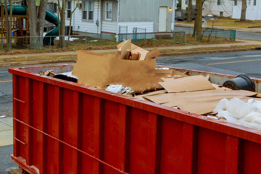 construction dumpster filled with debris
