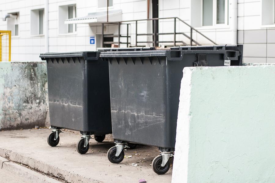 residential dumpsters behind building